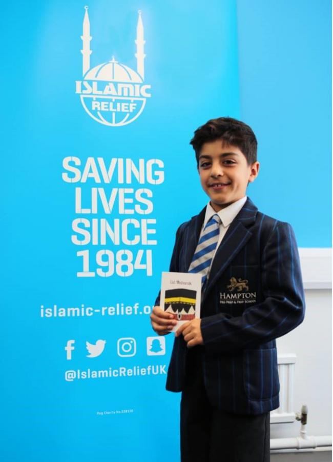 Omer Olcer with his Eid card design at Islamic Relief UK Headquarters.