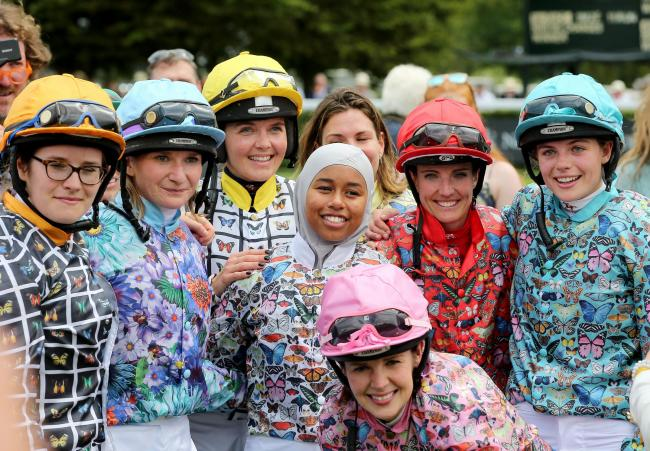 Khadijah Mellah (centre) poses with her fellow jockeys after winning the Magnolia Cup on Haverland during day three of the Qatar Goodwood Festival at Goodwood Racecourse (Mark Kerton/PA)