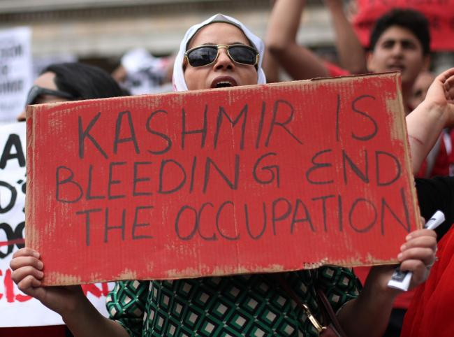 Demonstrators during a Freedom For Kashmir protest against the Indian government - after it stripped Kashmir of its Indian-administered special status - in Trafalgar Square, London. (Yui Mok/PA)