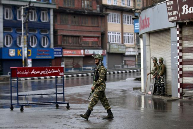 Indian paramilitary soldiers patrol during security lockdown in Srinagar, Indian controlled Kashmir, Wednesday, Aug. 14, 2019. India has maintained an unprecedented security lockdown to try to stave off a violent reaction to Kashmir's downgraded status.