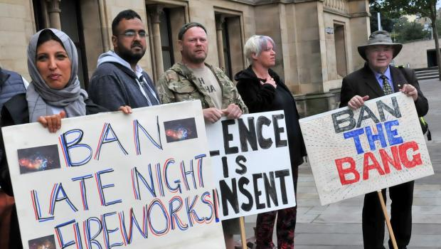 Asian Image: Campaigners outside Bradford's City Hall to oppose the use of fireworks late at night
