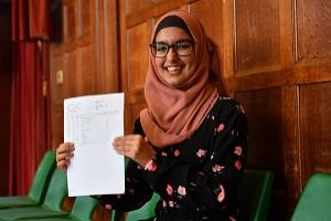 Aliyah Begum, who got all grade 9s, with her GCSE results at King Edward VI High School for Girls, in Birmingham. (Jacob King/PA)