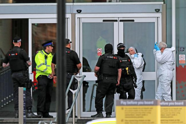 Police and forensic officers outside the Arndale Centre in Manchester where at least five people have been treated after a stabbing incident.Friday October 11, 2019.  (Peter Byrne/PA)