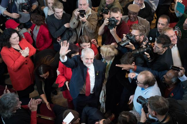 Jeremy Corbyn surrounded by photographers and supporters during Labour's General Election campaign launch