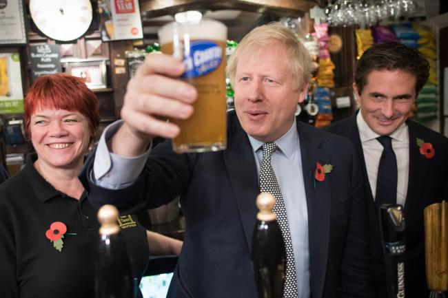 Prime Minister Boris Johnson and defence minister, Johnny Mercer MP (right) in the Lych Gate Tavern (Stefan Rousseau/PA)