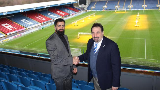 Yasir Sufi is welcomed to the club by Rovers CEO Steve Waggott in the Next Generation stand at Ewood Park