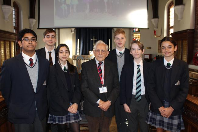 95-year-old Harry Olmer with year 8 and 9 students from Chigwell School