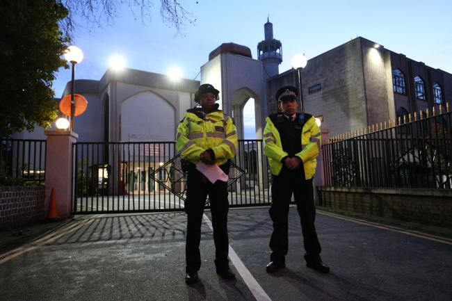 Police officers outside the main entrance to the London Central Mosque near Regent's Park, North London, after morning prayers.  (Jonathan Brady/PA)
