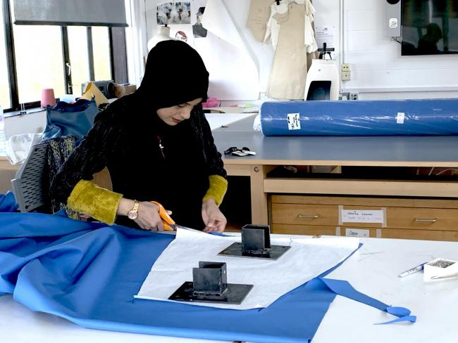 Fashion designers  produce isolation gowns for hospital
