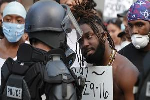 Demonstrators face off with police in riot gear in downtown Raleigh, N.C during a protest over the death of George Floyd, who died in police custody on Memorial Day in Minneapolis. (Ethan Hyman/The News & Observer via AP)
