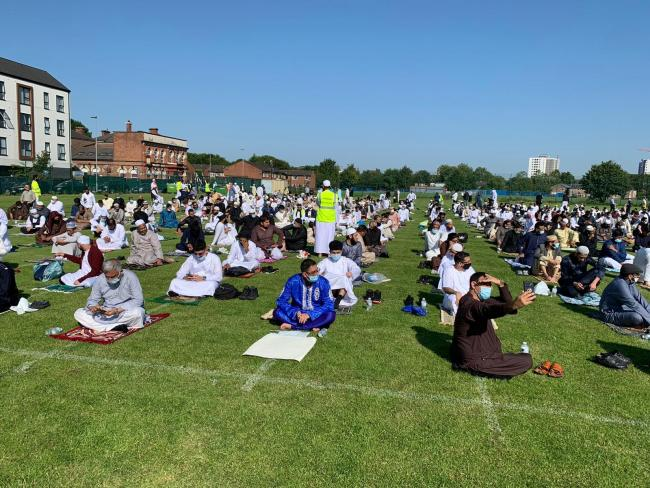 Worshippers at Trafford Eid prayers WERE social distancing despite claims by passing motorist
