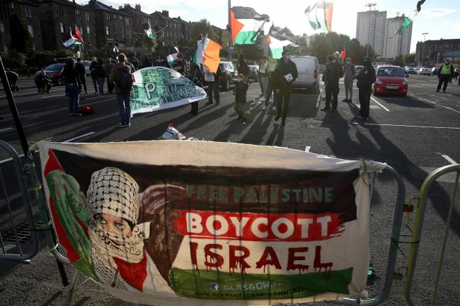 A banner stating Free Palestine Boycott Israel bought by protesters outside the ground before the UEFA Nations League Group F match at Hampden Park, Glasgow 4 September.  (Andrew Milligan/PA)