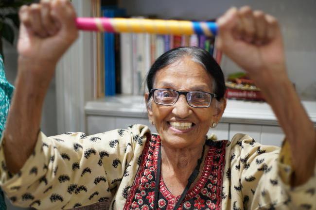 Handout picture of a care home resident in an Oomph! exercise class