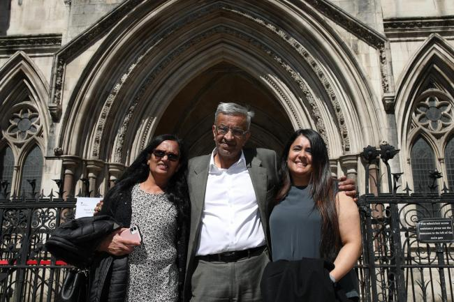 Former post office worker Vijay Parekh from Willesden, with his wife Gita (left) and daughter Bhavisha, outside the Royal Courts of Justice, London, after having his conviction overturned by the Court of Appeal.