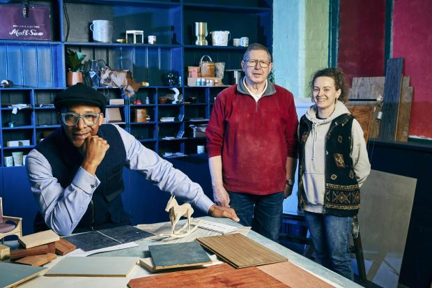 Asian Image:  From left, Jay Blades and Graham and Becky, who helped make the wooden picture frame for Imran Khan on the show