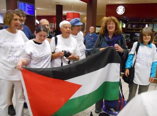 Peace activist arrives back in UK