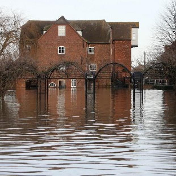 A house stands in flood water in Tewksbury, Gloucestershire