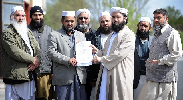 Syed Zafar Hussain and Imam Musta Qeem Shah with the Imams' statement on sexual grooming
