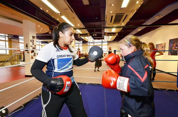 Asian Image: Saira Tabasum spars with a young partner in the Bradford ring
