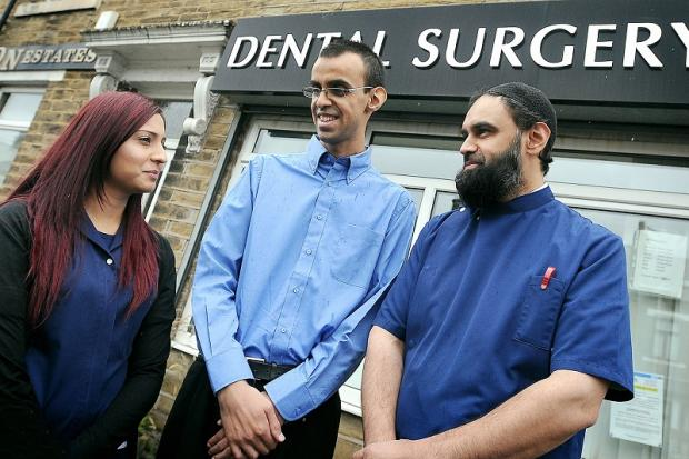 Rangzab Bashir, centre, visiting his brother, dentist Dr Sha