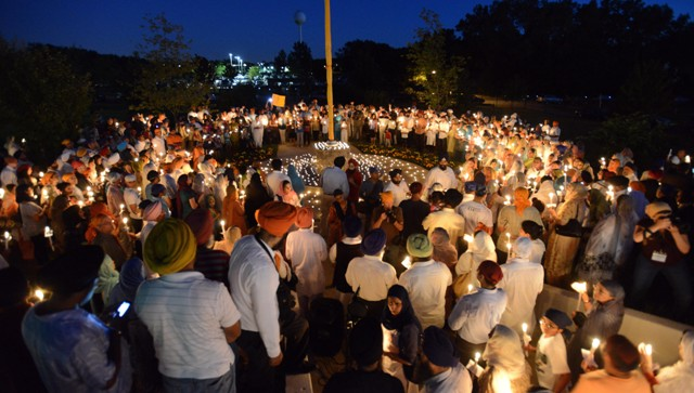 The vigil was held in memoriam of those killed and wounded in a weekend Sikh temple shooting near Milwaukee. (Picture by: Daily Herald, Mark Welsh)