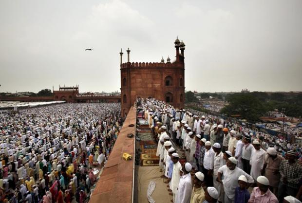 Indian Muslims offer prayer on the last Friday of the holy month of Ramadan at Jama Maszid, in New Delhi