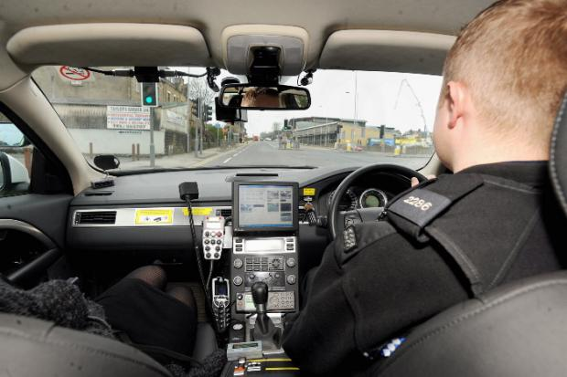 Police check out the road for uninsured drivers