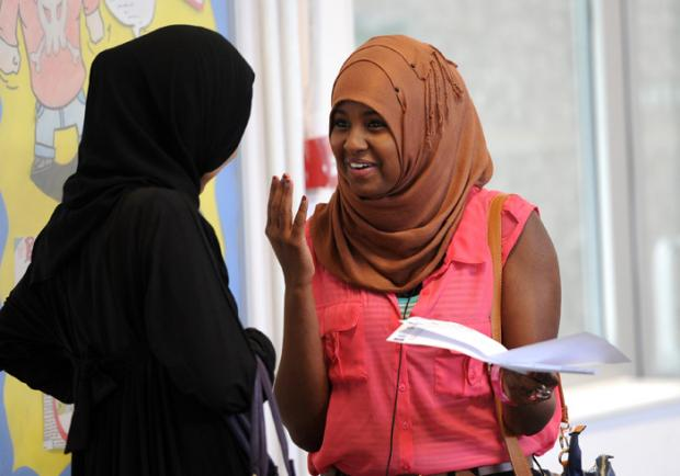 Naima Mohamed (right) reacts as she receives her GCSE results at Woodside High School in Wood Green, London.