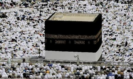 Muslim pilgrims circle the Kaaba as pray inside the Grand mosque in Mecca, Saudi Arabia, Monday, Oct. 22, 2012.