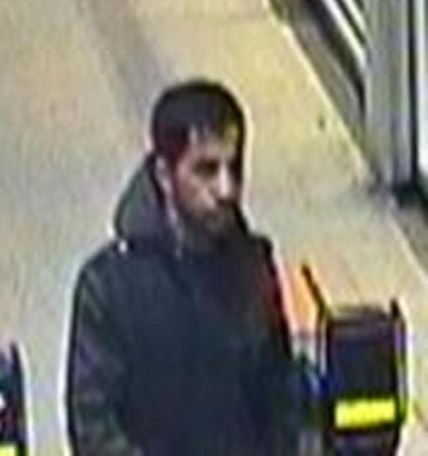 British Transport Police handout CCTV image of the man they want to trace after a bottle of hydrochloric acid was left on a train which caused a station to be shut and a major response from the emergency services.