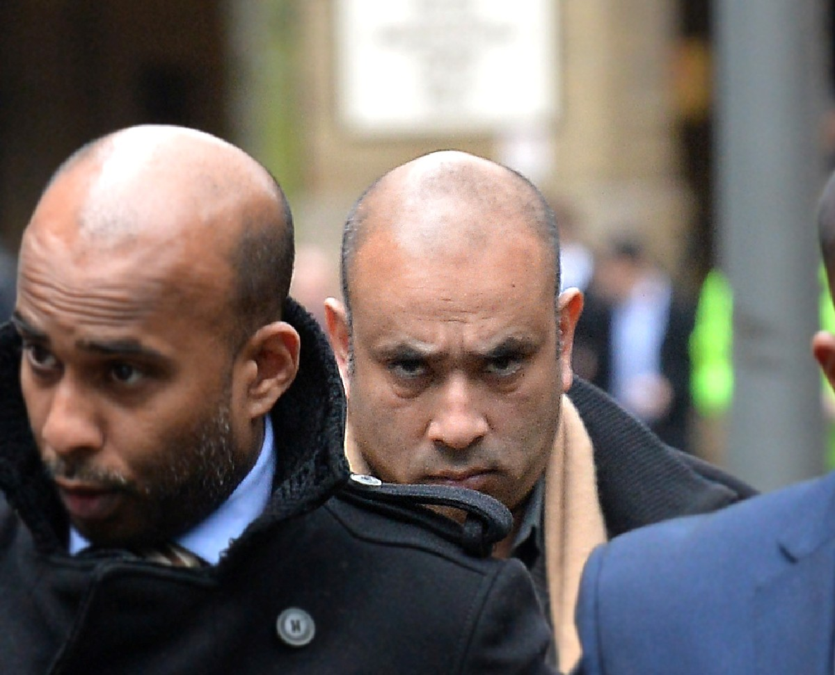Mohammed Ferdhaus (centre) arrives at Southwark Crown Court in central London, where he was jailed today for laundering at least half a million pounds from a crash-for-cash insurance scam.
