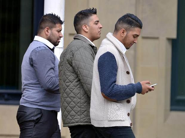CONVICTED: Leaving Bradford Crown Court are (left to right) Aqeeb Khalifa, Hassan Hussain and Mohsin Hussain