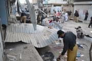 Pakistani investigators collect evidence from the site of a suicide bombing in Quetta, Pakistan,