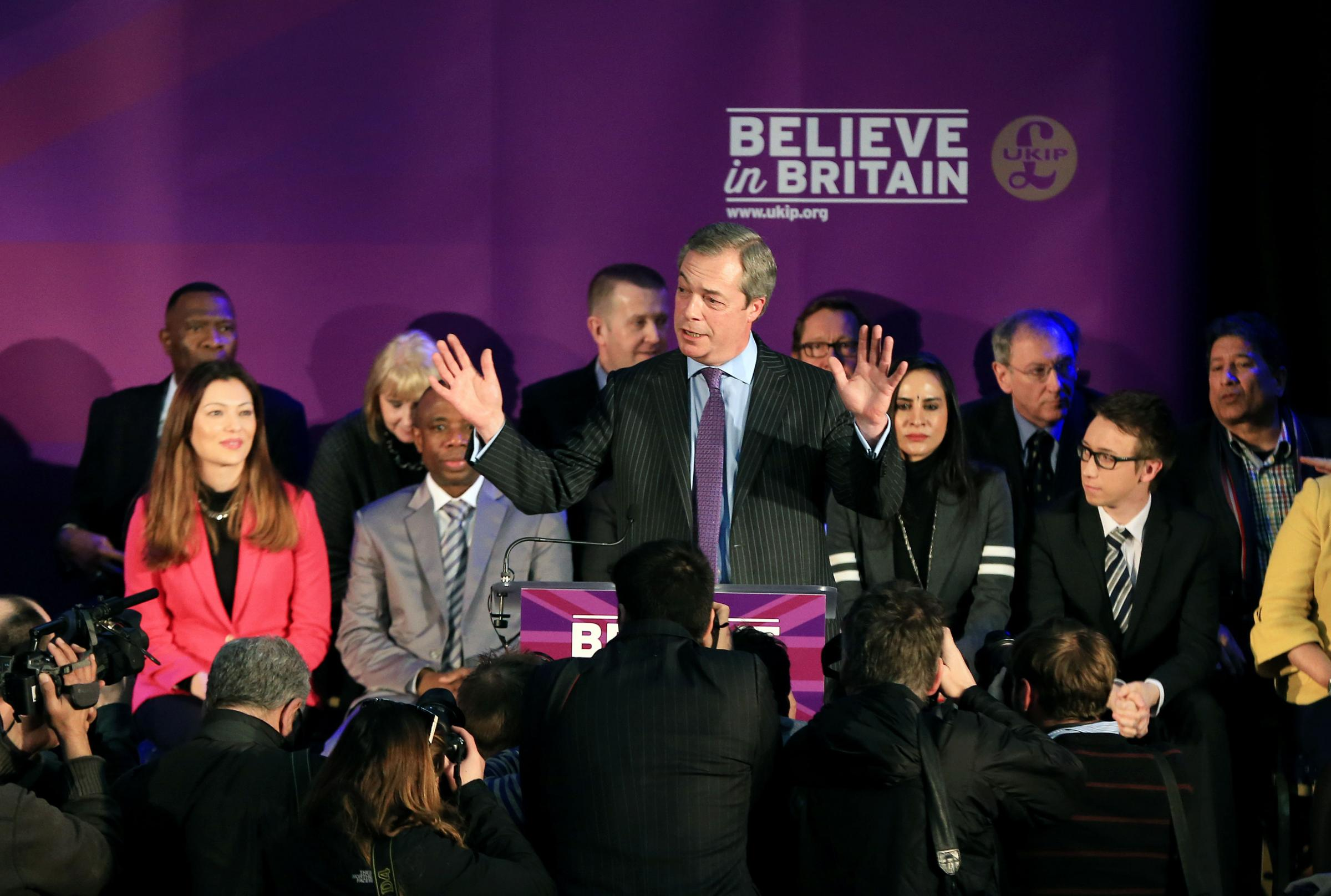 Ethnic minorities spotted behind Nigel Farage prove Ukip 'okay with Asians and blacks'