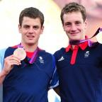 Asian Image: Jonny Brownlee, left, has been ruled out until September with a stress fracture of his femur