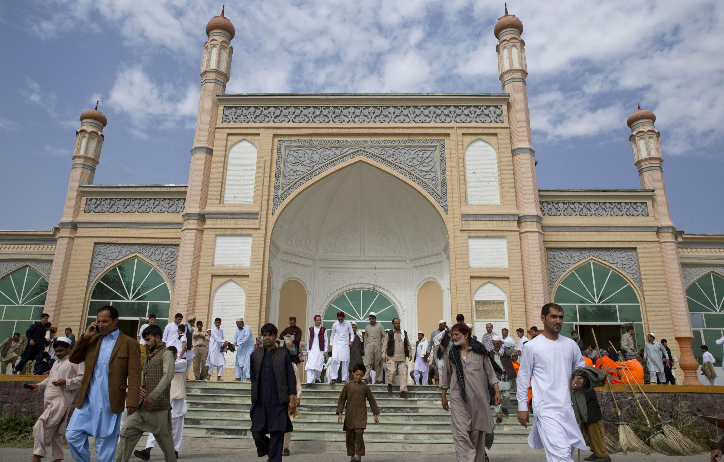 Afghan men leave after Eid Al-Fitr prayers in Eid Gah mosque in Kabul, Afghanistan, Friday, July 17, 2015. Eid al-Fitr prayer marks the end of the holy fasting month of Ramadan.(AP Hossaini).