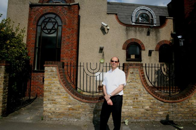 Woodford Liberal Synagogue Rabbi Richard Jacobi outside the old synagogue