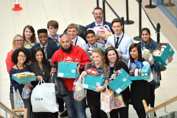 Asian Image: SUPPORT: Pupils at Bradford Academy have been collecting goods for Syrian refugees camping in Calais, left