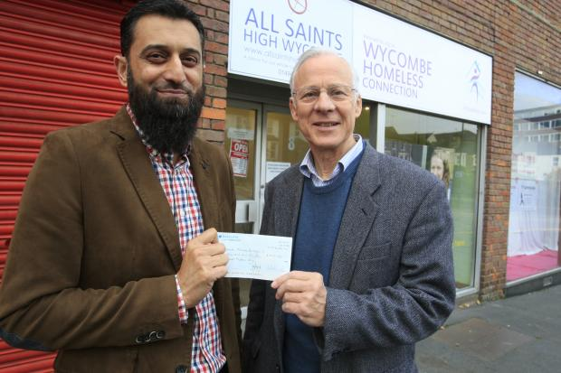 Asian Image: 23 Oct 2015Cheque Donation to Wycombe Homeless Connection after Mount Snowdon Climb - done that Islamic group could give more to the community - with L to R : Raja Akbar and Michael Bowker . By Anita Ross Marshall for News (44164347)