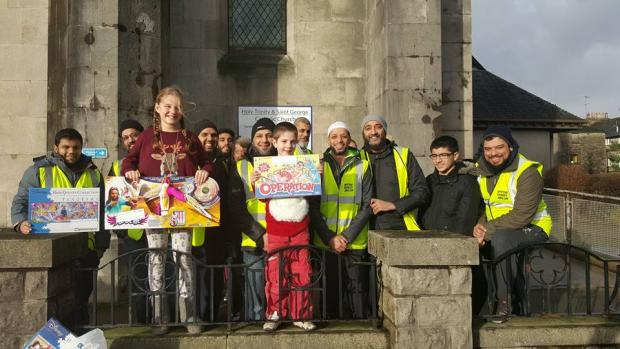 Asian Image: A group of Muslim friends from east London dropping off brand new toys at Holy Trinity & St George Church