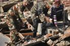 Indian soldiers and locals remove debris from a damaged building after an earthquake in Imphal, capital of the northeastern Indian state of Manipur, Monday, Jan. 4, 2016.