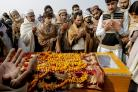Pakistani security personal are on alert during the funeral of a victim killed in an attack on Bacha Khan University in Charsadda, Pakistan, Thursday, Jan. 21, 2016.