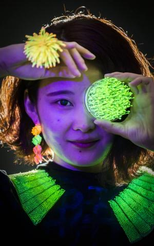 Asian Image: Designer Wanshu Li with her Luminous jewellery that was inspired by jellyfish and anemone during the Edinburgh College of Art degree preview show. (Danny Lawson/PA)