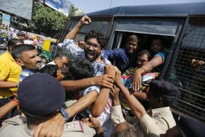 Asian Image: Policemen detain Dalit leader Jignesh Mevani during a protest by sanitation workers in Ahmadabad, India. Mevani, a leader of the lowest rung of India´s caste hierarchy, joined a protest demanding permanent jobs for sanitation workers who had been employed on contract basis for several years in the Ahmadabad Municipal Corporation. (AP Photo/Ajit Solanki).