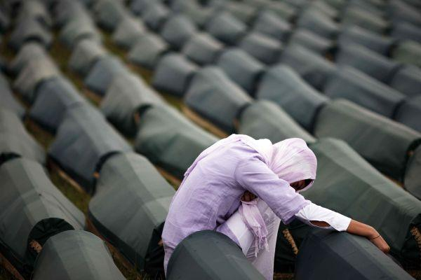 A woman of Srebrenica mourns her loved ones following the exhumation from mass graves the bodies of Muslim men and boys in 2011