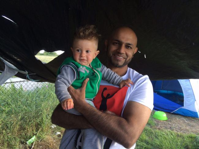 Shazad Shauket (right) on previous visits to assist refugees