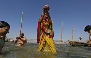 Asian Image: Hindu devotees offers prayers to the Sun god after taking a holy dip at the Sangam, the confluence of the Ganges and Yamuna and the mythical Saraswati, on the occasion of Hindu festival of Shivaratri, that marked the last day of the annual traditional fair of Magh Mela, in Allahabad. Shivaratri, or the night of Shiva, is dedicated to the worship of Lord Shiva, the Hindu god of death and destruction. (AP/Rajesh Kumar Singh)