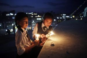 Asian Image: Nepalese students light candles to mark the second anniversary of a devastating earthquake in Kathmandu, Nepal. Two years ago, Nepal was ravaged by a massive 7.8-magnitude earthquake that killed nearly 9,000 people and left another 4 million homeless as their humble homes built from brick and stone were toppled within seconds. (AP/Niranjan Shrestha)