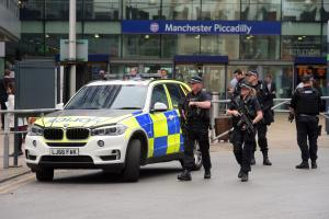 Armed police outside Manchester Piccadilly station in Manchester today (Wednesday May 24)
