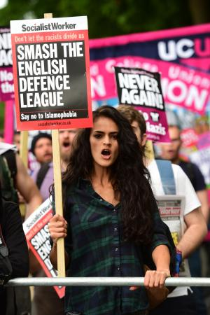 Asian Image: A woman protests against the English Defence League (EDL) in central London on Saturday 24 June.  (David Mirzoeff/PA )